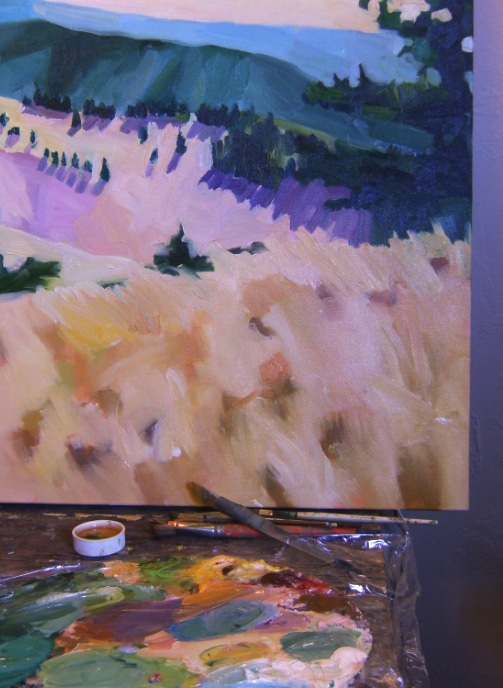 oil landscape painting in progress with palette