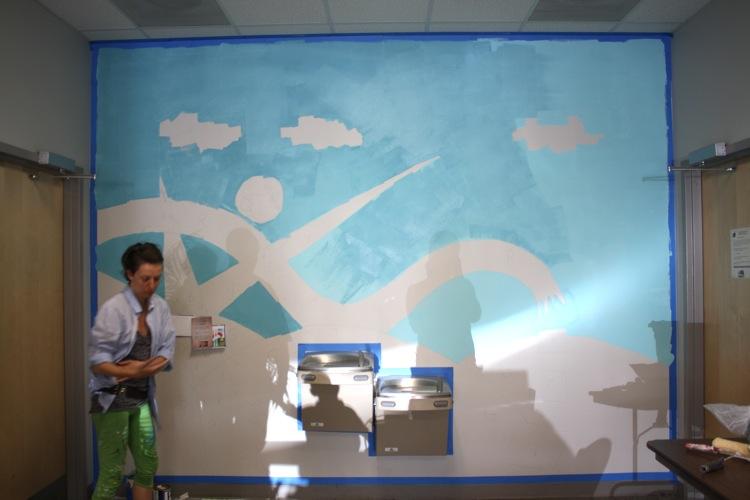zada tagli working on mural at greesboro irc