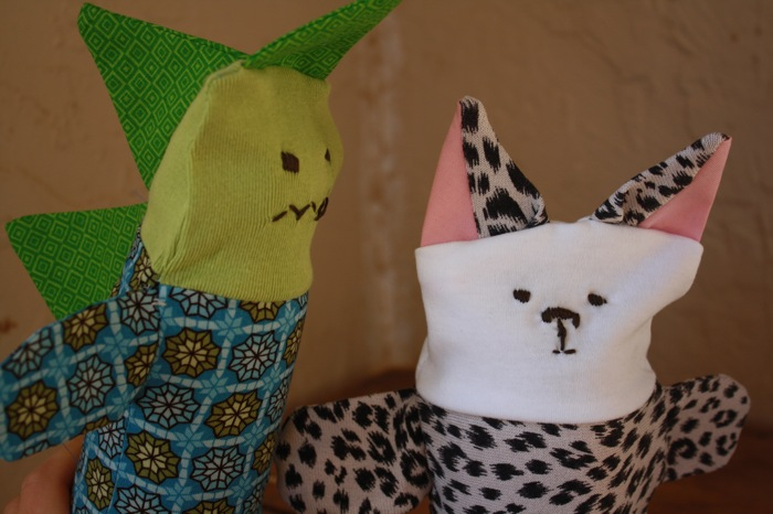 dinosaur and cheetah puppets