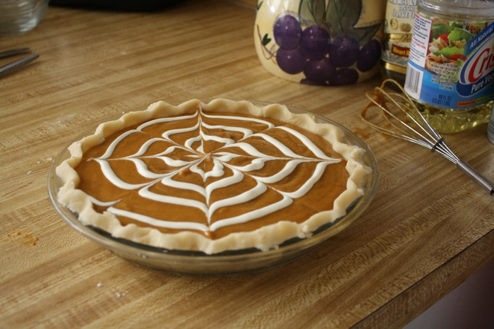 picture of pumpkin pie with sour cream design on top