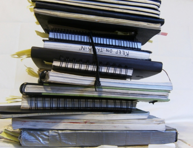 photo of a pile of sketchbooks