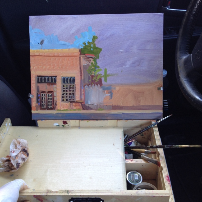 Painting in progress resting in the driver's seat while I stretch my legs.