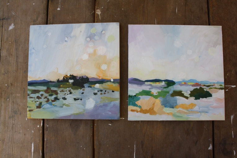 photo of two oil paintings landscapes of new mexico
