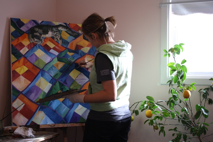 Jessie Dodington painting in her New Mexico studio