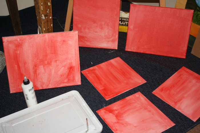 photo of canvases with red wash