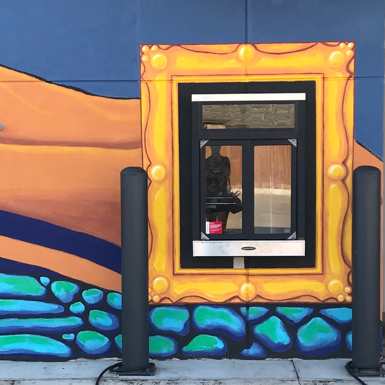 take out window mural that looks like a golden frame